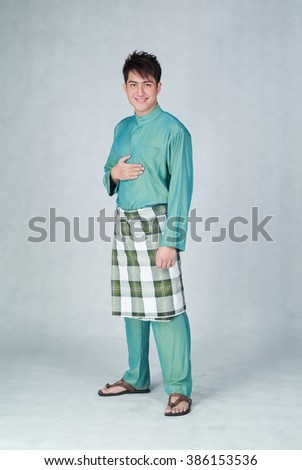 Man or Malay man with welcome gesture during ramadan - stock photo