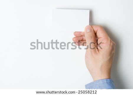Man or person presenting a business card to introduce himself