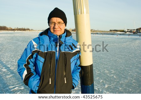 Man outdoors in winter - stock photo
