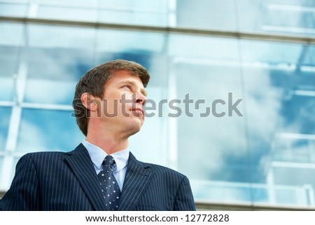 Man outside office building, looking away - stock photo