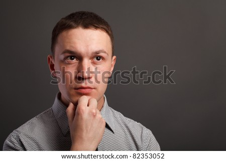 Man over gray background - stock photo