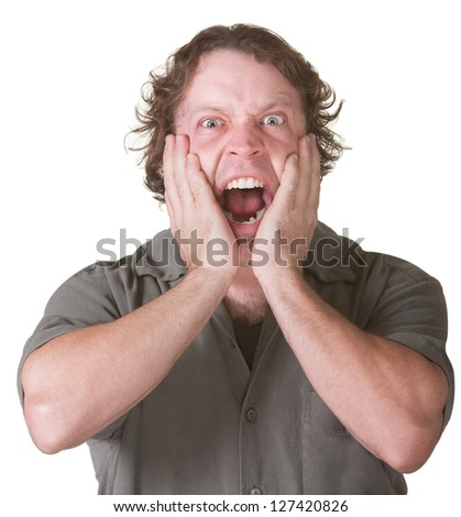 Man over white background overreacting with hands on face - stock photo