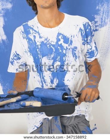 man paint the wall - stock photo