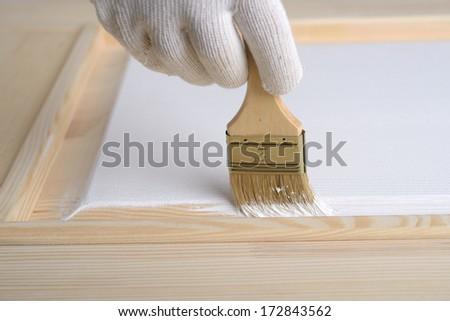 Man painting a wooden door - stock photo