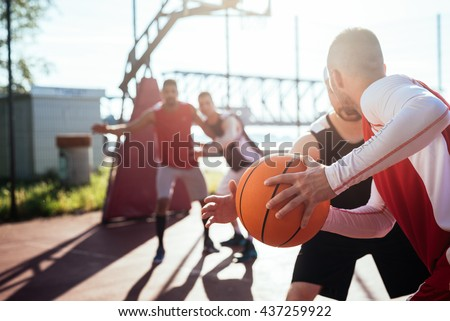 Man passing the ball to another player. - stock photo