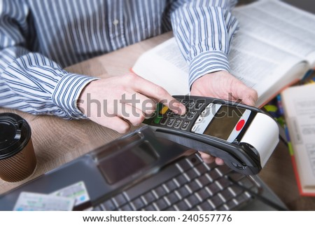 Man paying with NFC technology on credit card,  - stock photo