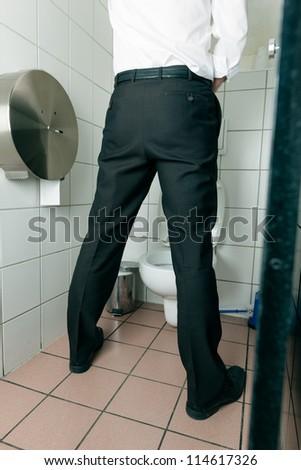 Man peeing in toilet - stock photo