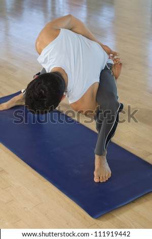 Man performing stretching exercise - stock photo