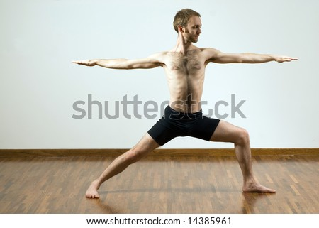 man performing yoga arms supporting body stock photo