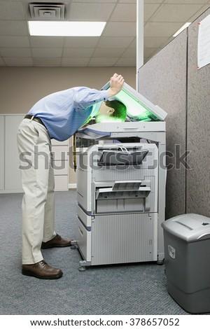 Man photocopying his head - stock photo
