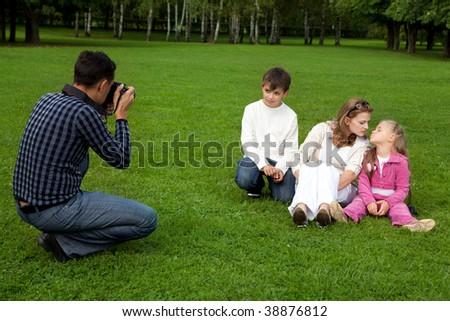 man photographer his family outdoors - stock photo
