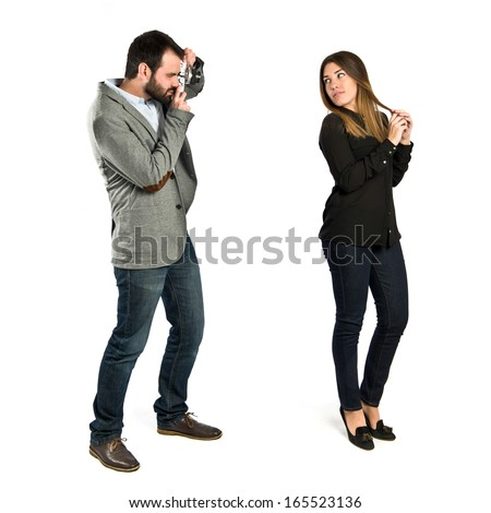 Man photographing a girl over white background  - stock photo
