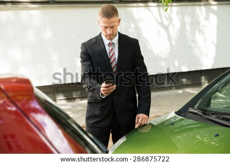 Man Photographing His Vehicle With Damages For Accident Insurance - stock photo