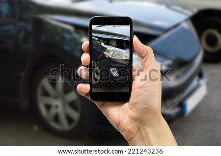 Man photographing his veiculo damages for accident insurance - stock photo