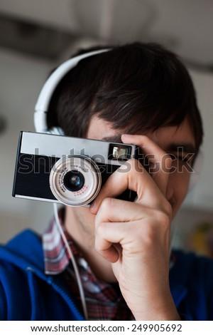 Man photographs on film camera - stock photo