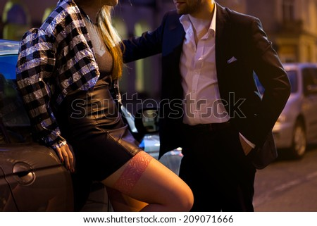 Man picking up a girl on the street - stock photo