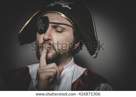 man pirate with eye patch and old hat with funny faces and expressive