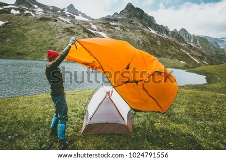 Man pitching tent c&ing outdoor Travel adventure lifestyle concept mountains journey vacations into the wild & Pitch A Tent Stock Images Royalty-Free Images u0026 Vectors ...