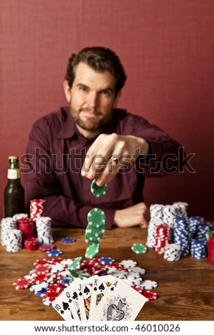 man placing wager against person with full house in poker - stock photo