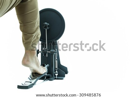 Man playing a base drum pedal isolated in black and  white background - stock photo
