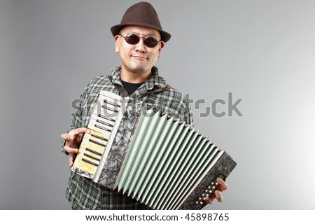 Man playing a French accordion.