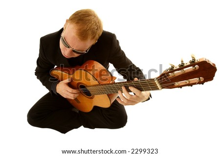 man playing a guitar isolated on white background - stock photo