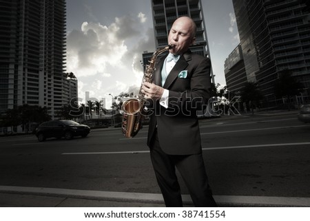 Man playing a saxophone in an urban setting