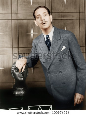 Man playing and doing silly things with a bust - stock photo