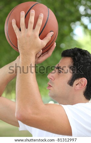 man playing basketball - stock photo