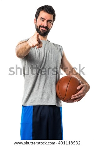 Man playing basketball pointing to the front