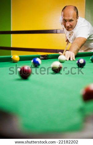 Man playing billiards - stock photo
