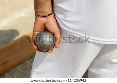 Man Playing Boule In Marseille France, Backside view - stock photo