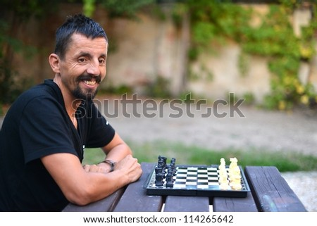 man playing chess - stock photo