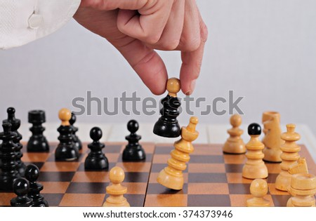 Man playing chess close up. Business strategy, success  and winner concept - stock photo
