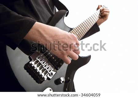 man playing electric guitar - stock photo
