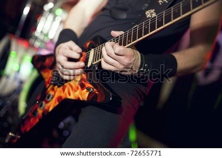 man playing electrical guitar - stock photo