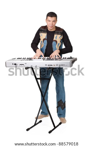 man playing electronic organ isolated on white background - stock photo