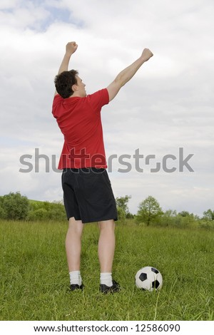 man playing football outside for recreation
