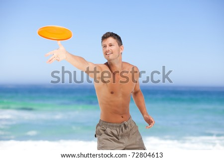 Man playing frisbee - stock photo