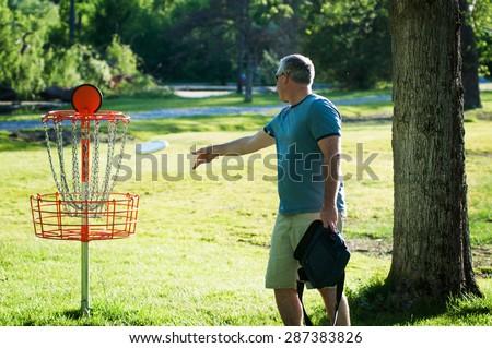 man playing frisbee golf - stock photo