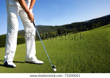 Man playing golf - stock photo