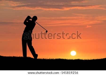 Man playing golf against sunset background. Focus on the Silhouette
