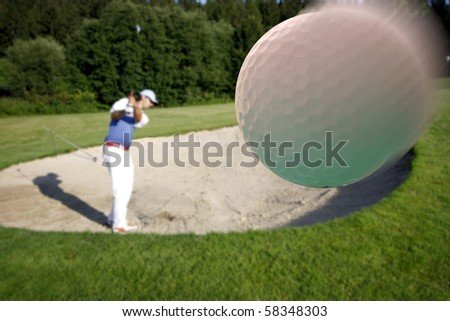 man playing golf from bunker - stock photo