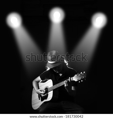 Man playing guitar. Black and white photo - stock photo
