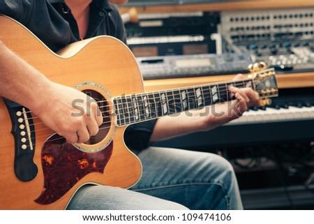 man playing guitar, close-up - stock photo