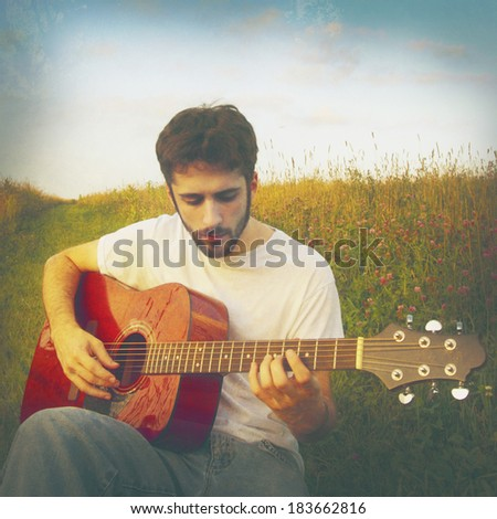 Man playing guitar, instagram style - stock photo