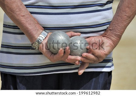 Man playing jeu de boules or also called petanque. - stock photo