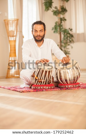 Man playing on traditional Indian tabla drums. - stock photo