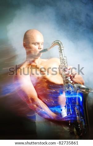 Man playing sax - stock photo