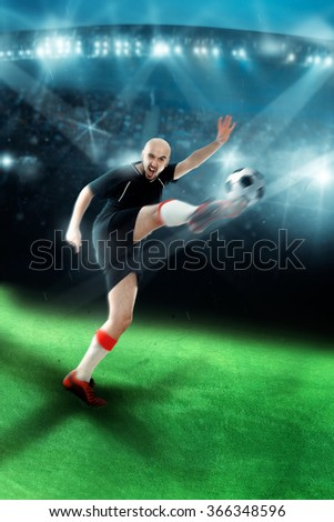 Man playing soccer and shooting a ball in the game. Football player shoots the ball. Professional game. Championship league.